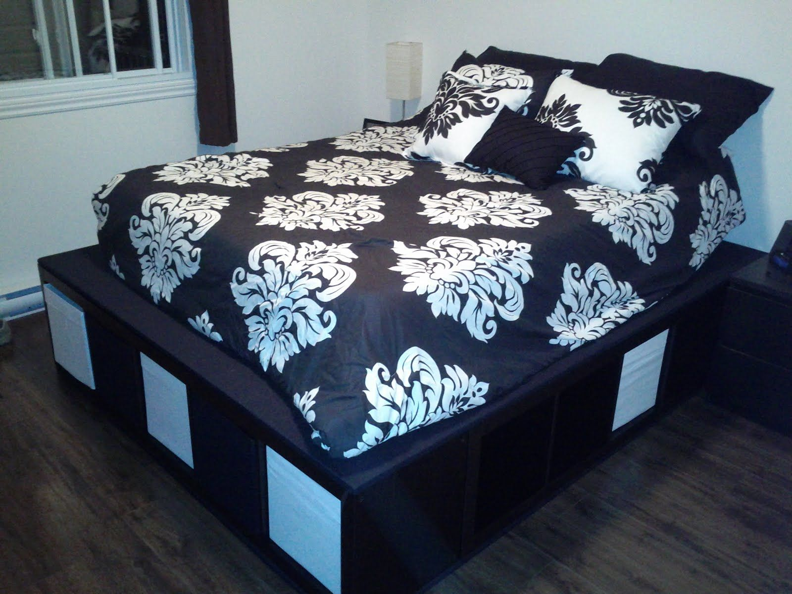 storage bed ikea hack. Materials: EXPEDIT Shelving Unit, 4 Plywood, 4X4, 5\u2032 Hinge, Black King Size Sheets Description: As We Live In A Condo Really Needed More Storage Space So Bed Ikea Hack