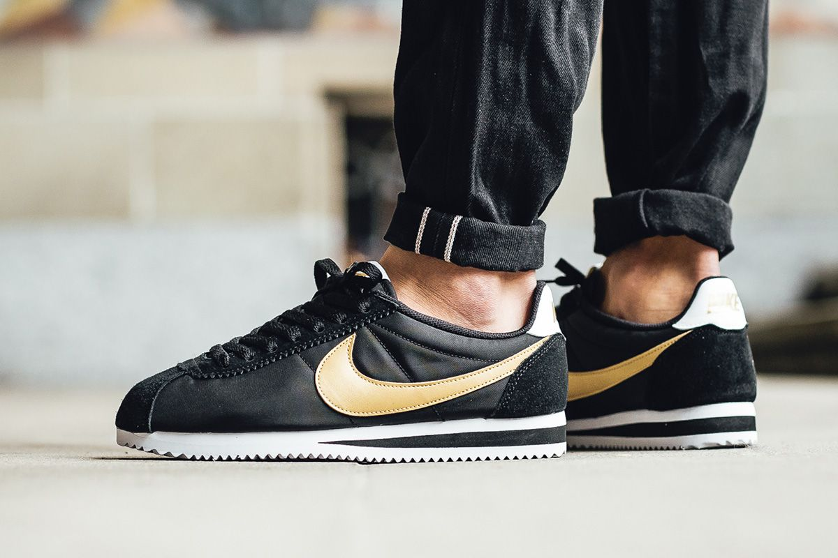 nike cortez black with gold