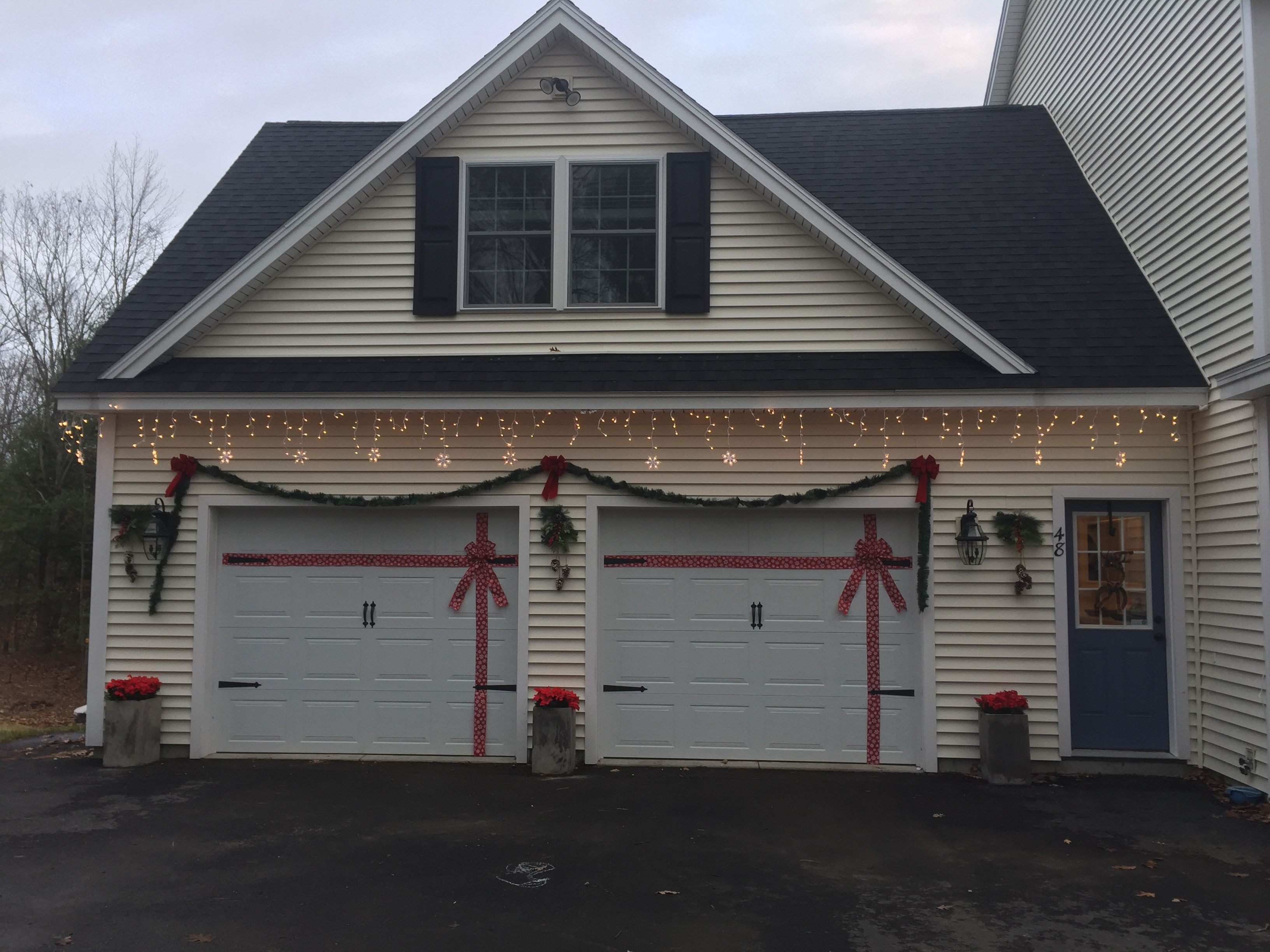 Wred Garage Door Garland Snow Flake Lights Poinsettias