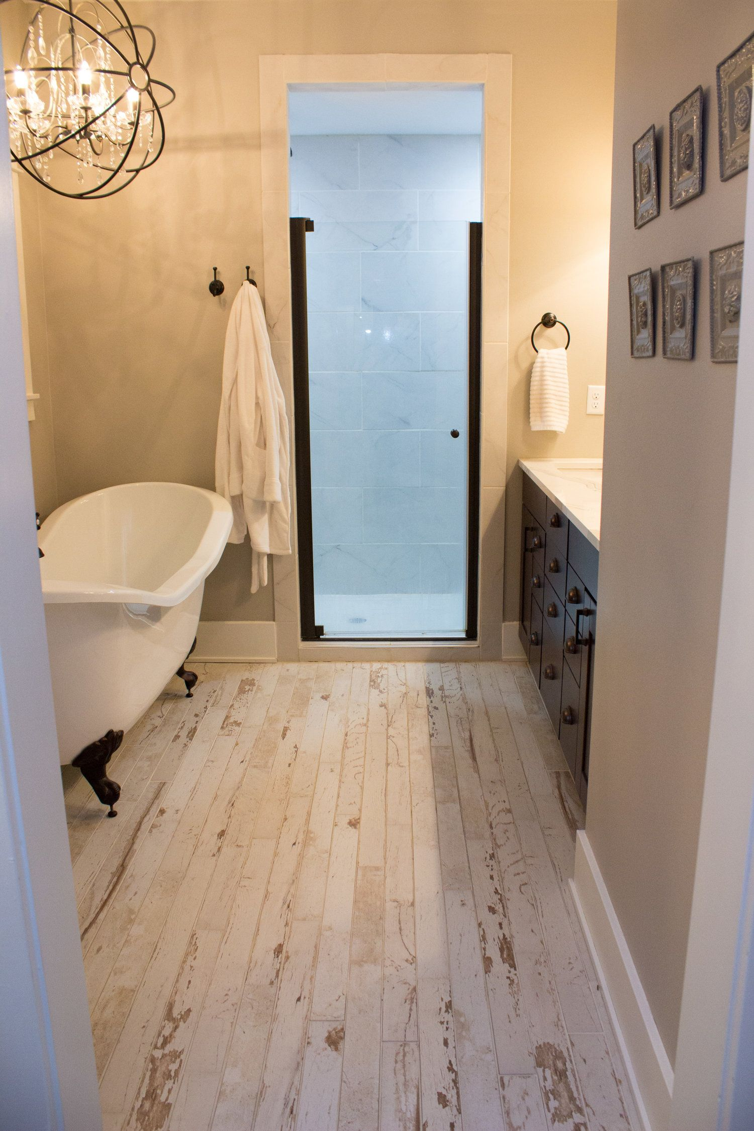 Rustic Bathroom In A New Home. Whitewashed Flooring With A