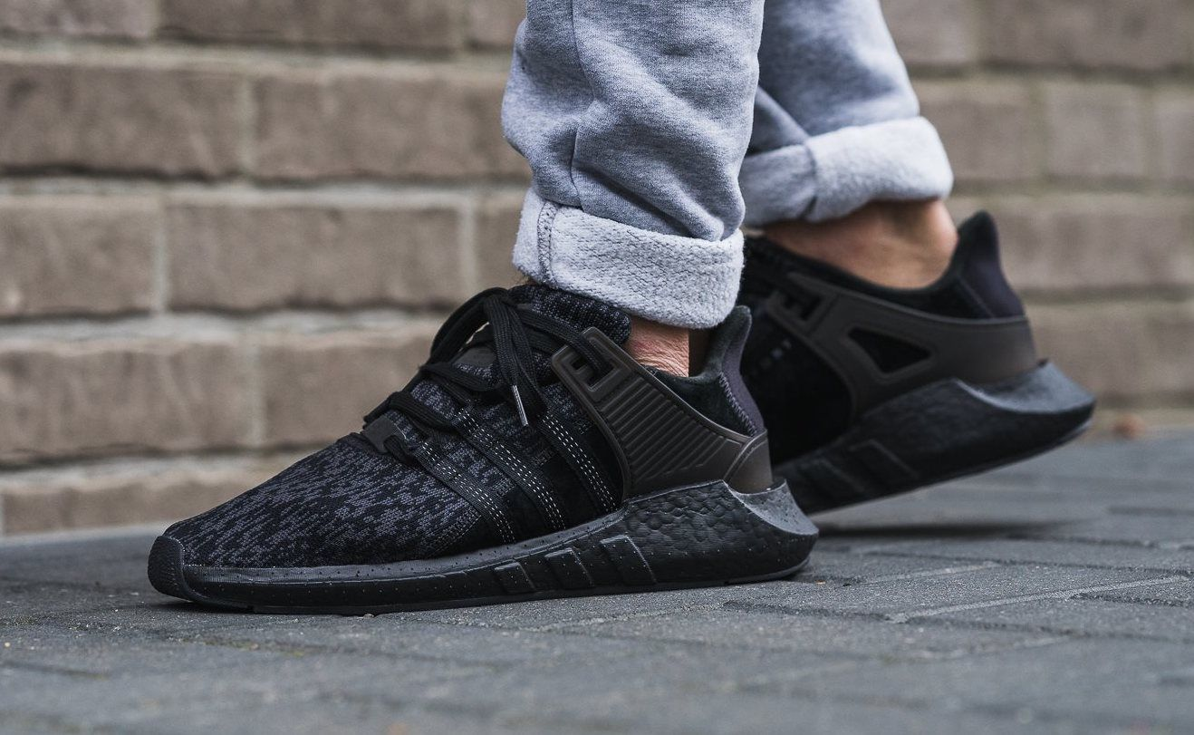 newest f310e 137ce The adidas EQT Support 9317 Triple Black is featured in a lifestyle look  and