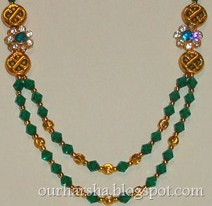 ethnic gold plated sidependant necklace with dark green bicone crystal beads traditional kerala