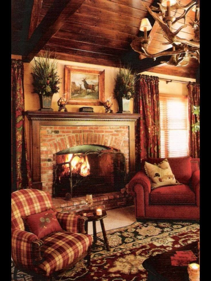 Warm Inviting Seating Area With Fireplace And Comfy Red Chairs Rustic Chic Living Room Christmas Living Rooms Cabin Living