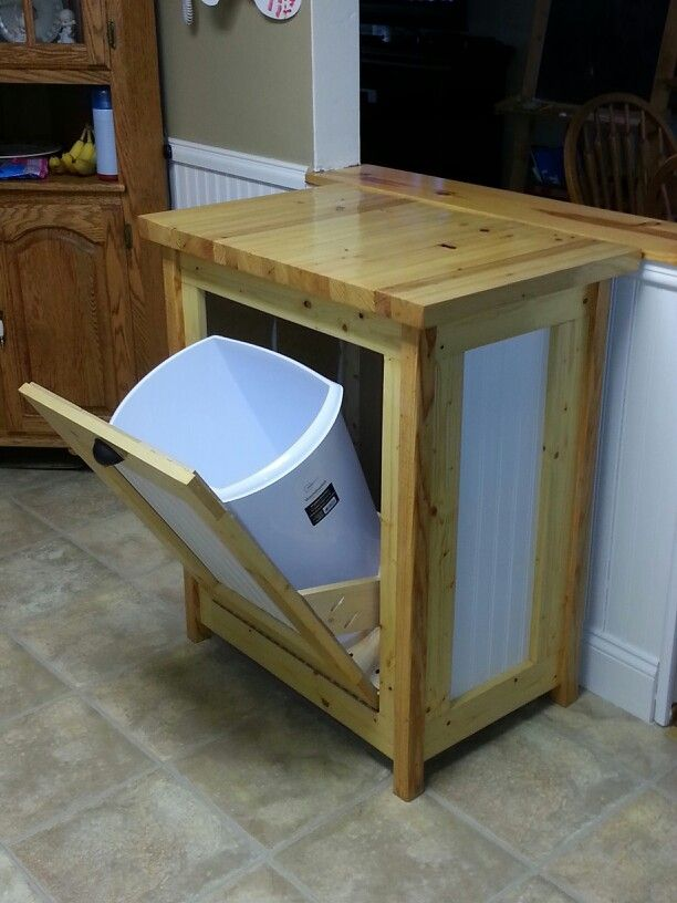 Hidden garbage can - I would use for dog food storage ...