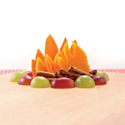 Campfire decoration for a dip, made with grapes, pretzels and carrots or mangoes