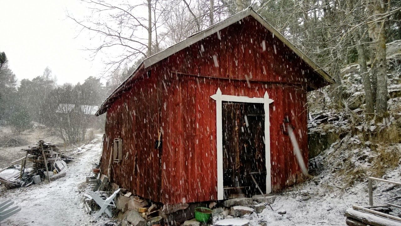 Winter arriving. Red cottage. Snowy fishing farm. Archipelago. Finland