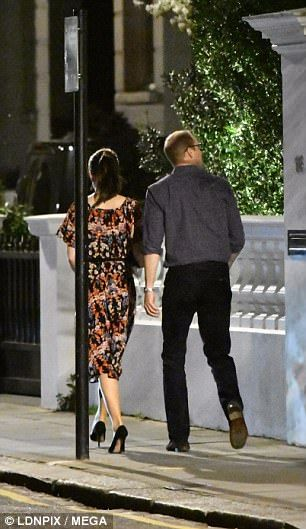 William wore jeans and an open-neck shirt while Kate wore an elegant floral dress...