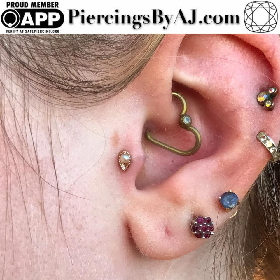 Pear piercing ideas  Fresh tragus piercing featuring a k rose gold pear harlequin with
