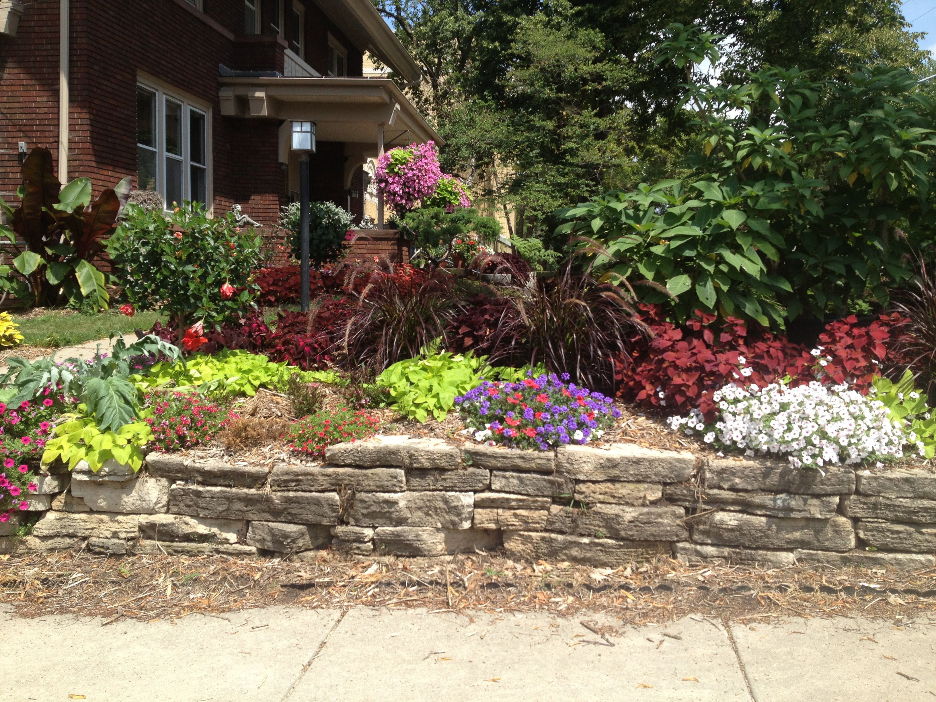 Landscaping, flowers, red brick house   Front yard ...