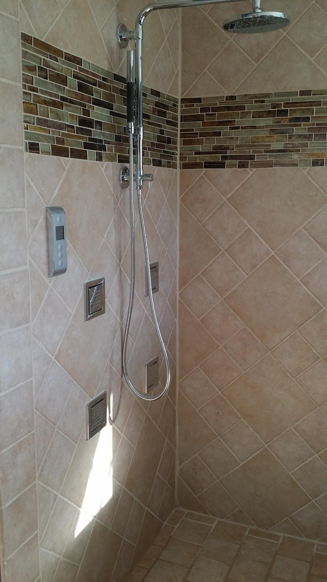 This Kholer water tile body spray is awesome ~ http://walkinshowers ...