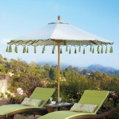 outdoor carousel umbrella in gingko perfect for backyard lounging