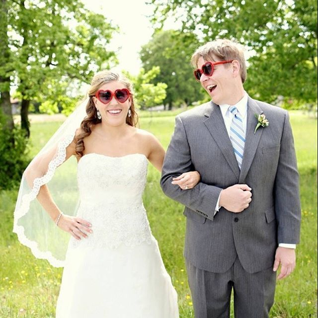 """We're all about FUN bride and groom portraits which is why we love this one from Susan and Fred's DIY wedding captured by @sarawhitebox! Heart shaped sunglasses are always a good idea! See this entire Something Turquoise wedding by searching """"DIY Craft Beer Wedding"""" on the site. #DIYWedding #DIYBride #NCWedding #NCWeddingPhotographer #WhimsicalBrideandGroom"""
