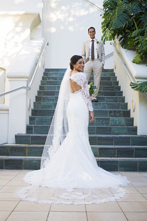 d3ed1b90dc6 San Diego wedding at the park hyatt aviara bride mermaid style gown with  lace sleeves and
