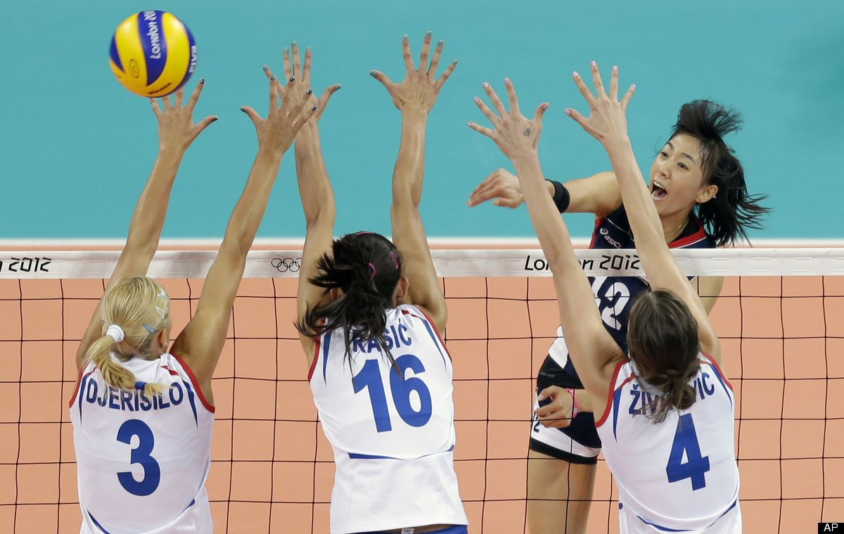 South Korea S Han Song Yi 12 Spikes The Ball Past A Line Of Serbia Defenders From Left Ivana Djerisil Women Volleyball 2012 Summer Olympics Summer Olympics