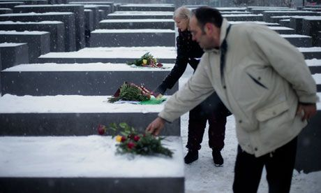 memorial day 2013 | People lay flowers at the Holocaust memorial in Berlin. Photograph ...