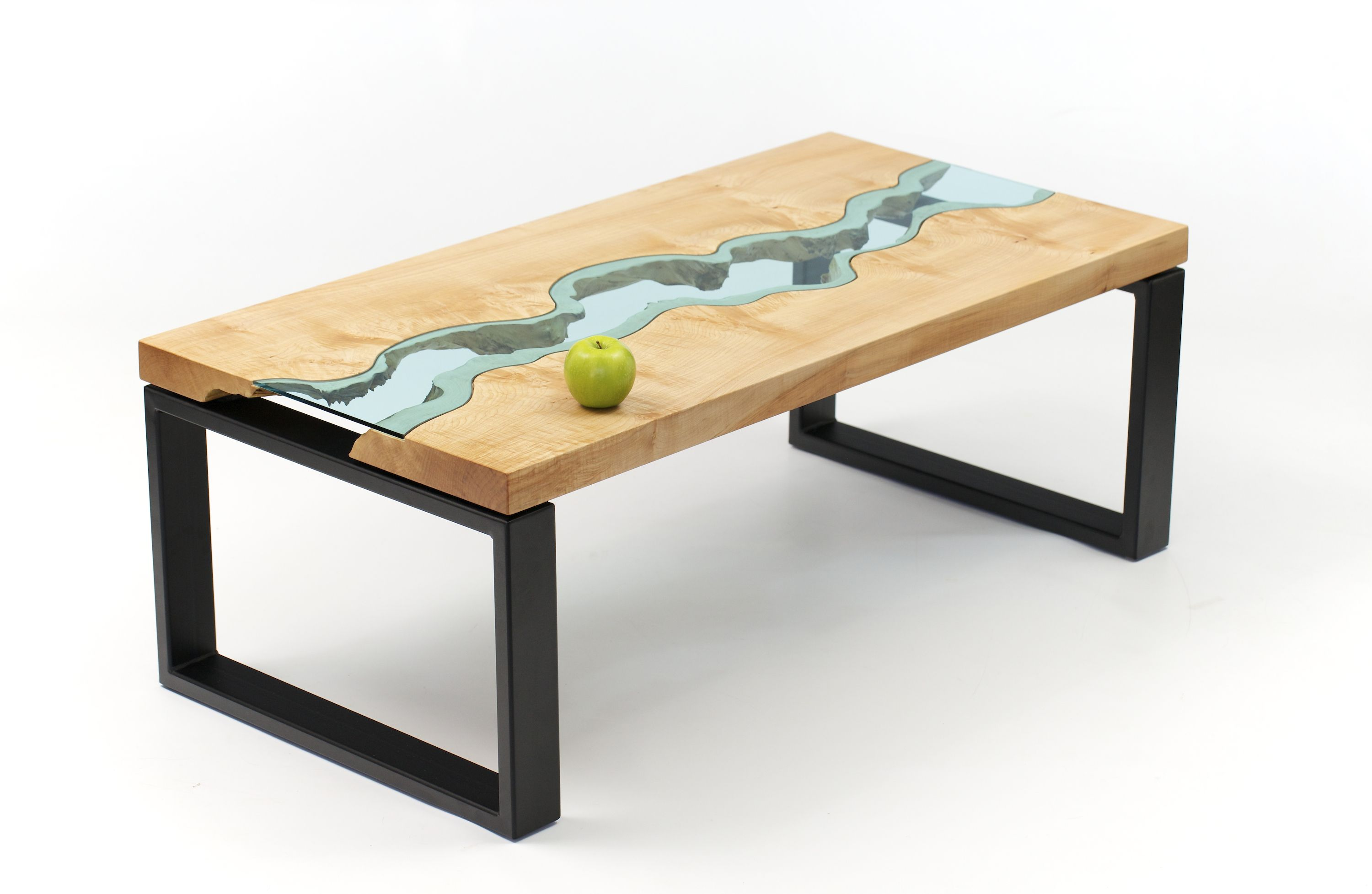 River Coffee Table No 2 is a table made of maple and glass It s