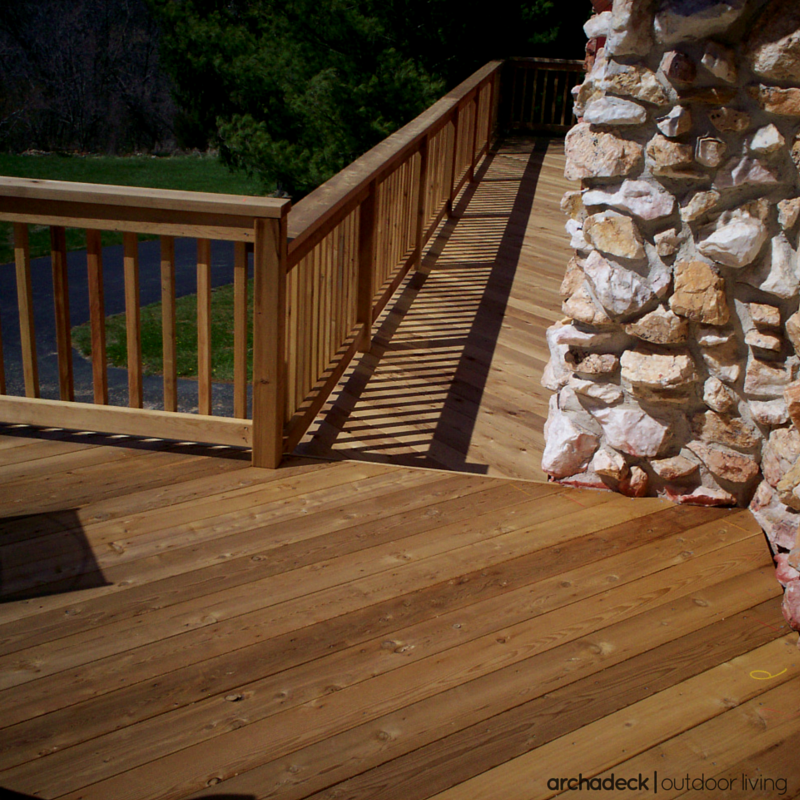 rustic all natural cedar decking with a stone wall on wow awesome backyard patio designs ideas for copy id=82134