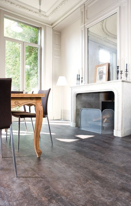 dark grey cork floors give a refined look to this white space