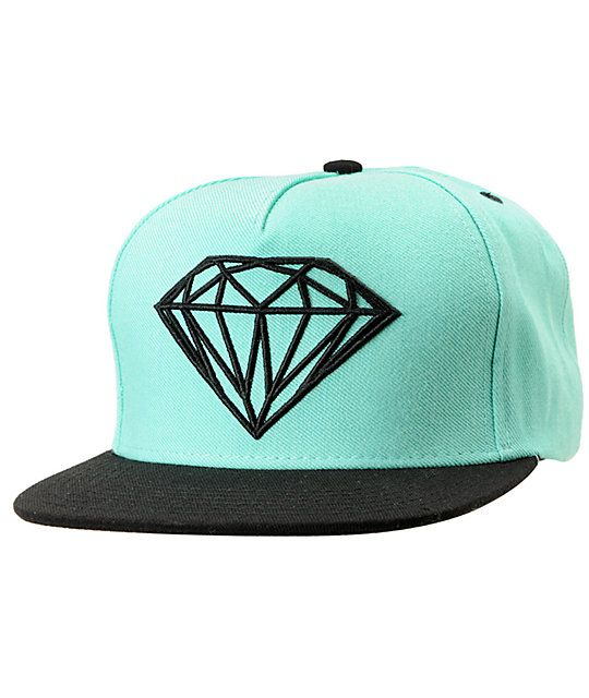 ed31139359e9a Make your mark in the Brilliant hat from Diamond Supply Co This Diamond  blue and black hat features a mint body