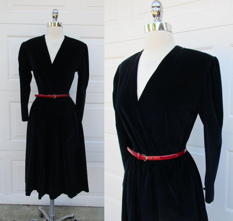 Black velvet cross bodice cocktail dress long sleeve pockets back