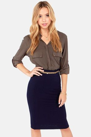 """Take every outfit from ho-hum to totally hot with the Getting Haute in Here Navy Blue Pencil Skirt! Incredibly soft knit has all the stretch you need to get a comfortable, curve-hugging look down a midi-length pencil shape with hidden elastic at the waist. Belt not included. Lined. Model is 5'8"""" and is wearing a size small. 95% Rayon, 5% Spandex. Dry Clean Only. Made with Love in the U.S.A"""