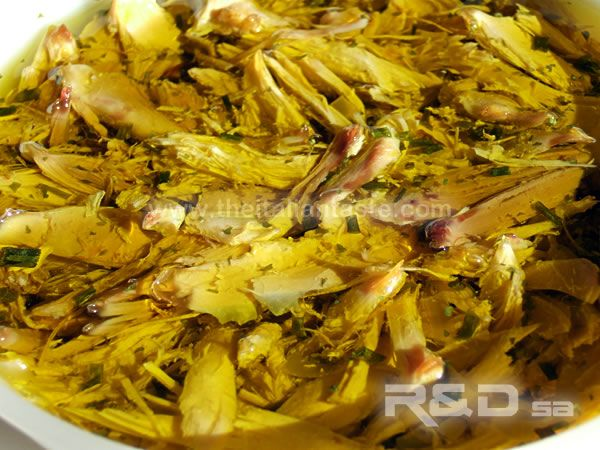 Photo of Capon in olive oil. Once capon is boiled, it is put in oil with aromatic herbs. …