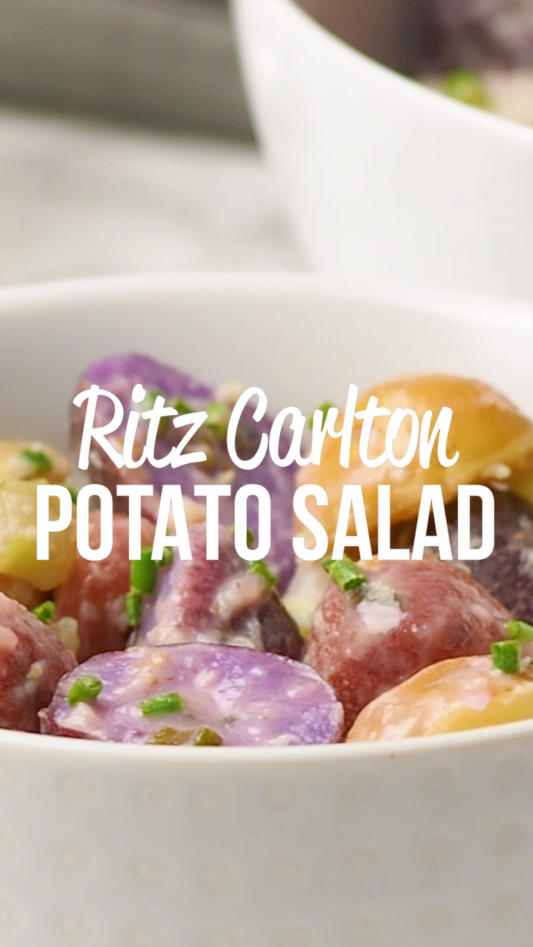 The Ritz Carlton Potato Salad Recipe - heirloom potatoes tossed in mayonnaise, celery, fresh chives and tarragon, and lemon juice - tastes amazing. Can make in advance and refrigerate overnight. Great for potlucks and cookouts. Everyone always asks for the recipe! #sidedish #potatoes #potatosalad #potluck #video #cookingvideo #recipevideo #makeahead #HealthyFoodForHealth