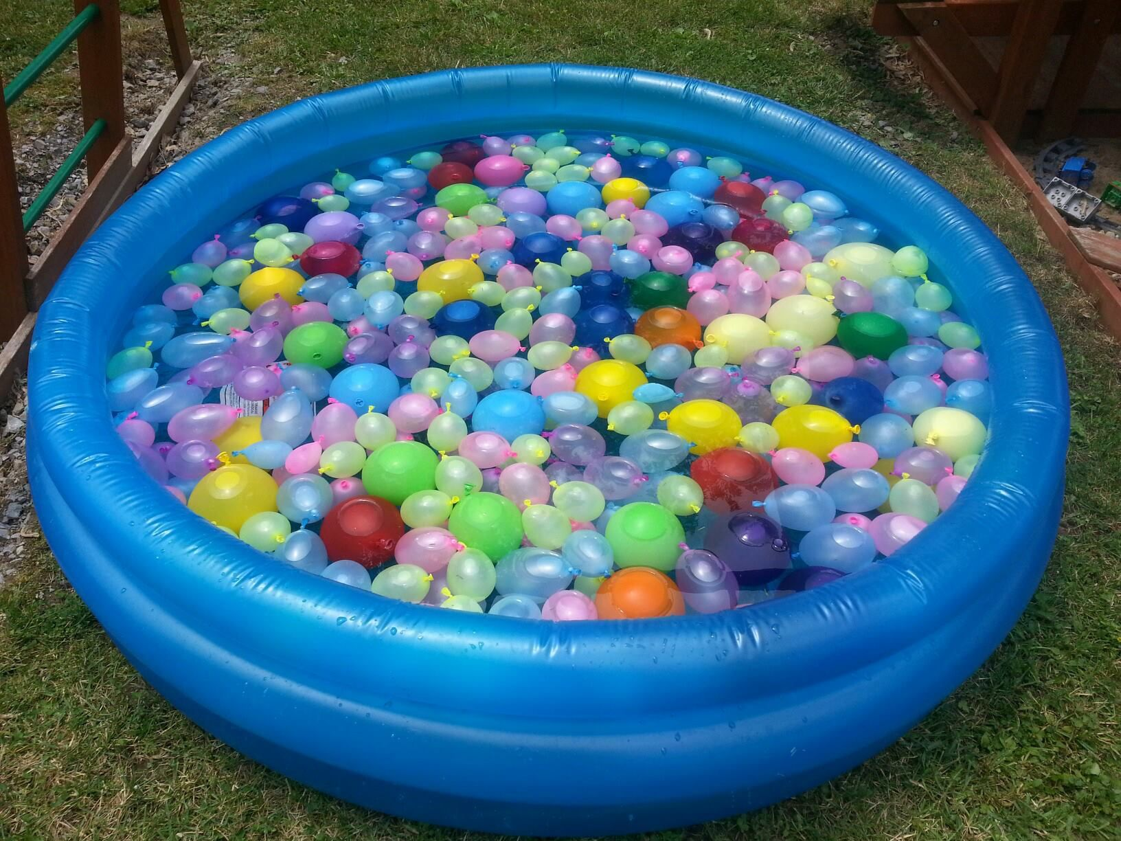 a pool full of water balloon fun care for small children that may put a