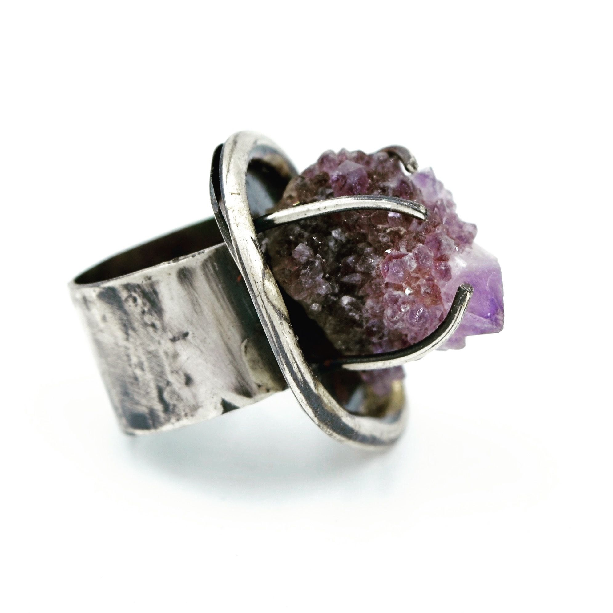 Contemporary Jewelry:  Sterling silver ring, set with a raw, natural Amethyst