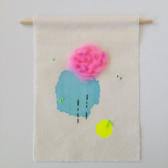 This piece is the third in my Neon Swatch collection of small wall hangings  It has been hand dyed and embroidered in turquoise and neon yellow, black and bright green with a puff of neon pink merino roving, on soft off-white cotton and hung from a stringless wood dowel  The edges are raw and the canvas has been washed to give it a soft natural texture with plenty of creases. The reverse is left to show the workings of the piece Each of my Neon Swatch wall hangings has been freeform stitched…