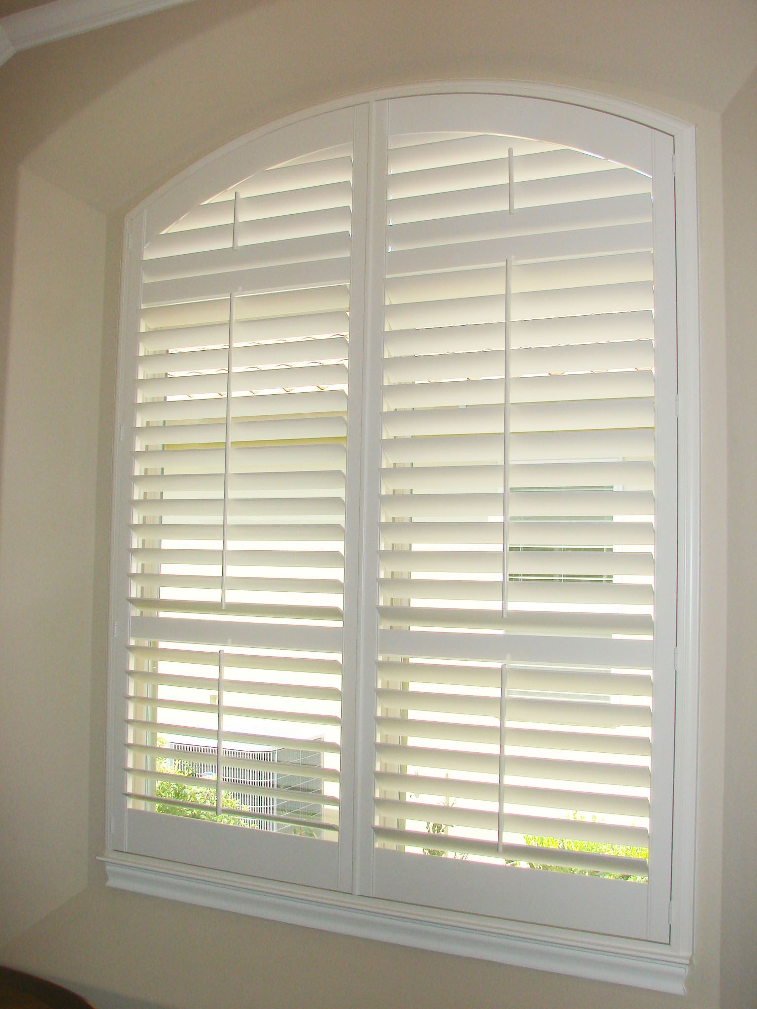 Custom made Arched Panel Plantation Shutters