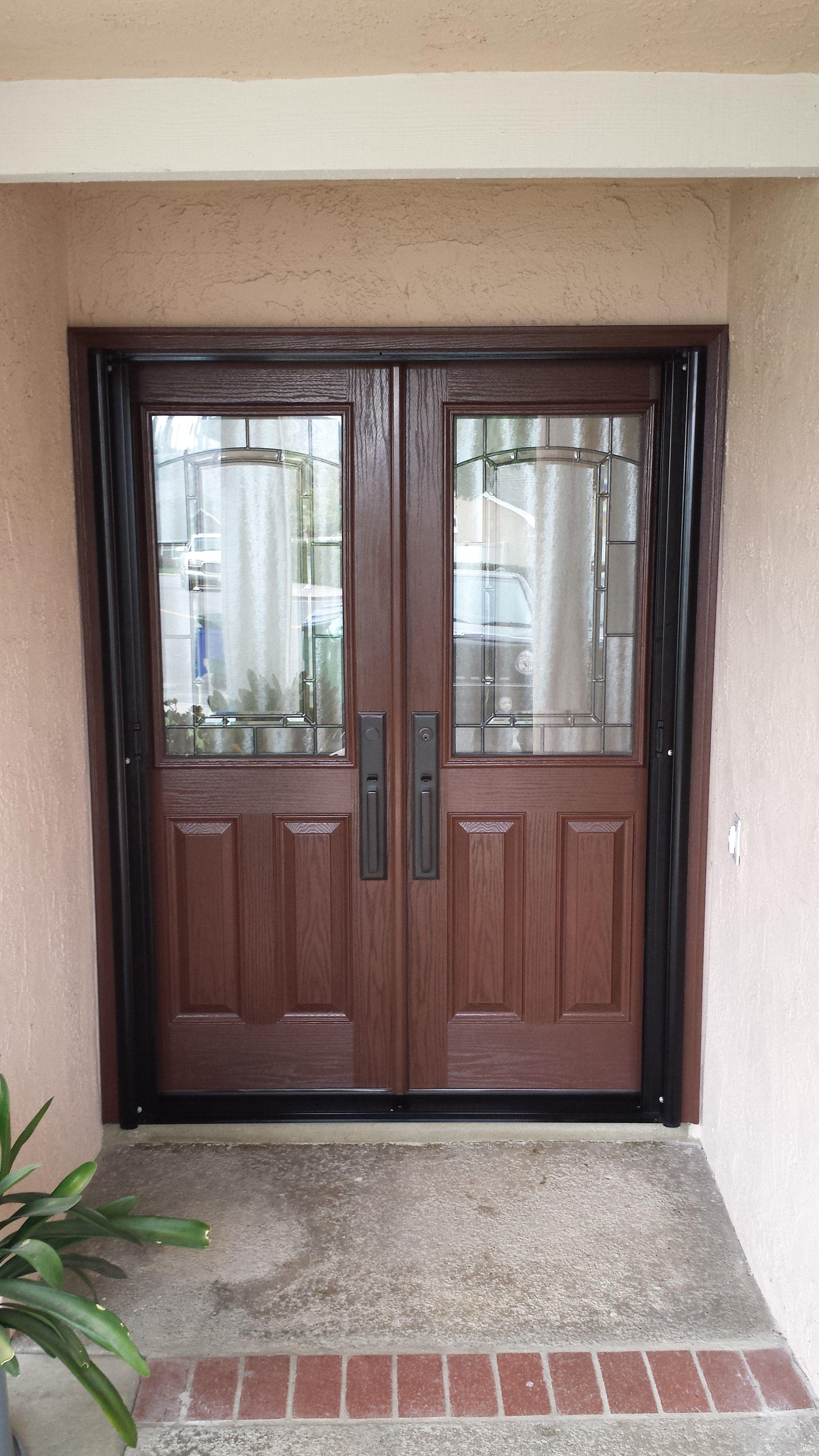 5 foot double door in fiberglass, stained. Exterior