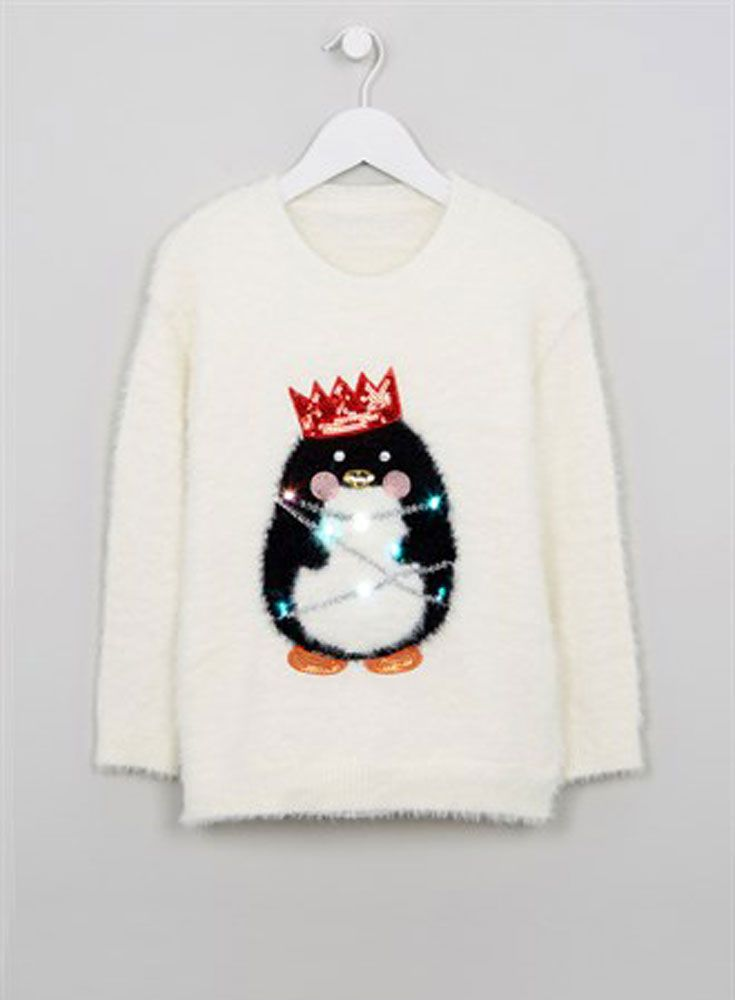 1cfa52f450f4 Christmas lights aren't just for your tree ... We love these festive jumpers  that, amazingly, light up, too! Matalan Kids Christmas Light Up Penguin  Jumper ...
