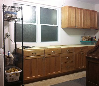 Reuse old kitchen cabinets in garage to create a workbench with ...