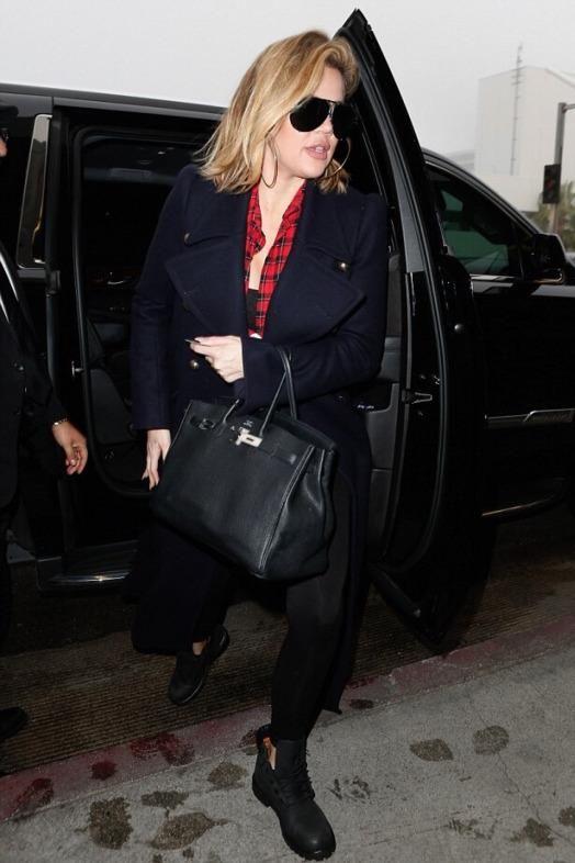 e95deebc1e24 Khloe Kardashian wearing Hermes 35cm Birkin Bag in Black, Timberland Boots  in Black, Porsche Design by Carrera 5621 Aviator Sunglasses and Chloe ...
