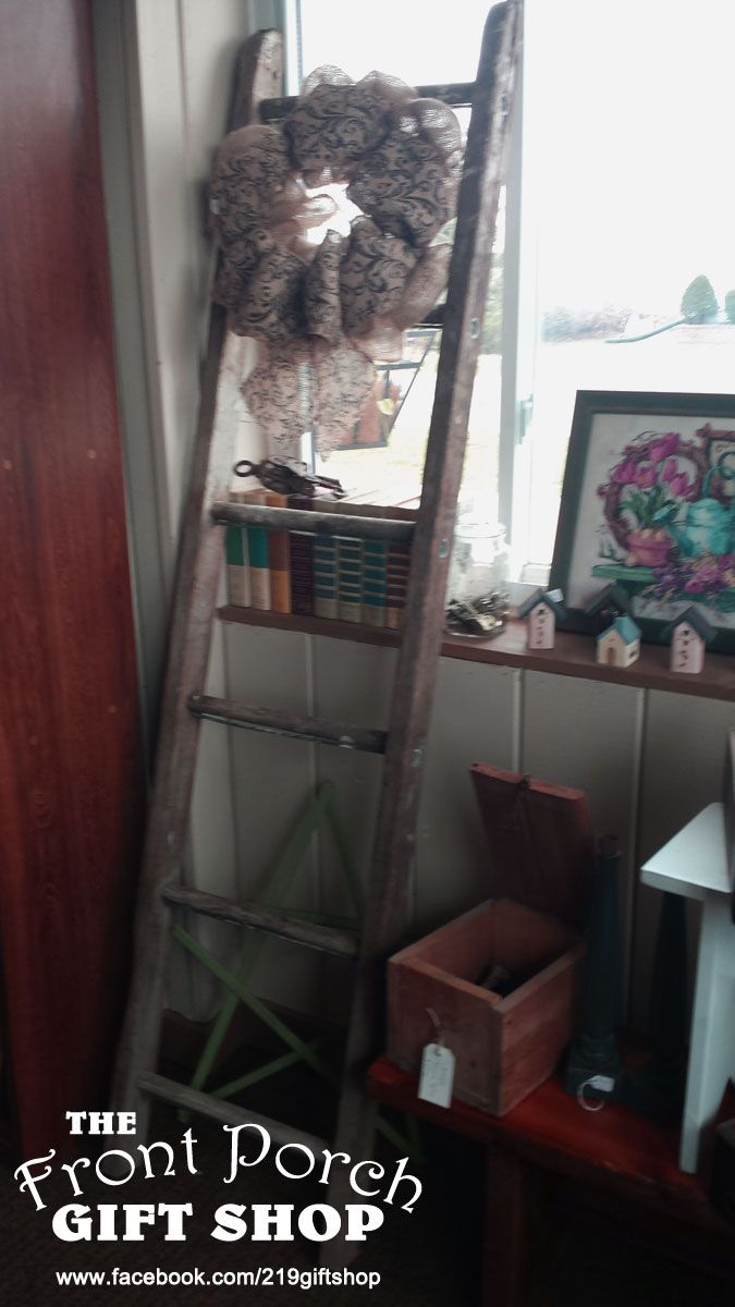 The front porch gift shop spring display wooden ladders wreaths