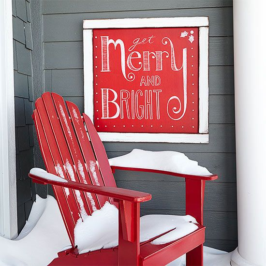 """Spread cheer in your neck of the woods with a festive holiday message. To make the Christmas sign, paint a piece of plywood with a mixture of plaster of Paris, water, and red paint. We went with """"Get Merry and Bright,"""" but you can add your favorite holiday sentiment using white chalk. Coat the sign in clear sealer to make it last year after year. /"""