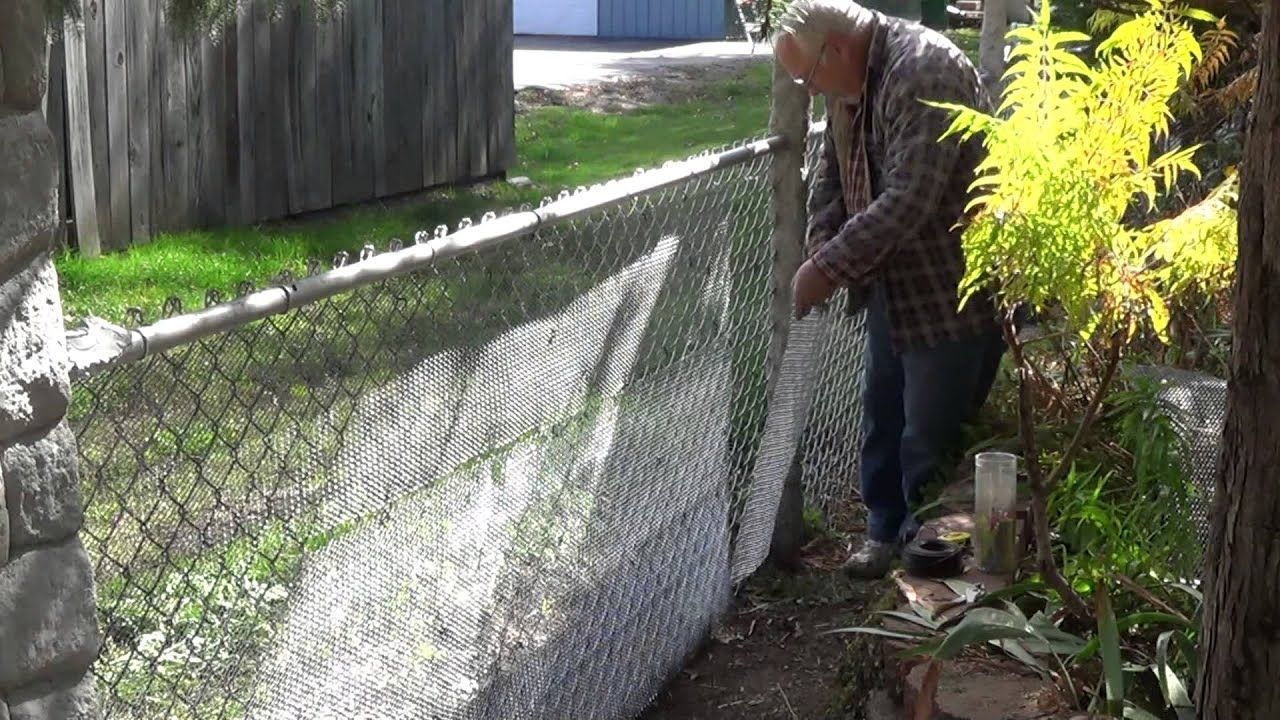 Converting My Chain Link Fence To A Stone Wall Youtube In 2020 Rock Wall Landscape Chain Link Fence Diy Retaining Wall