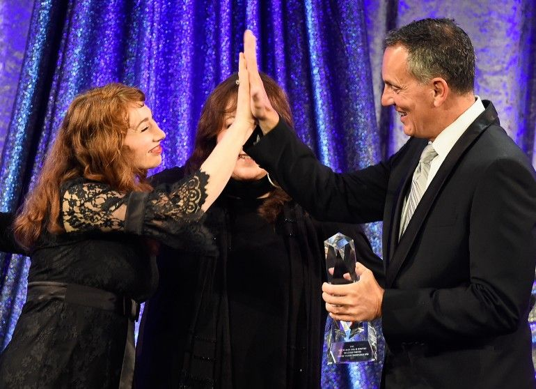 MAY 14, 2015 (L-R) Singer-songwriter Regina Spektor, BMI Vice President, Film/TV Relations Doreen Ringer-Ross and BMI President & CEO Mike O'Neill onstage during the 2015 BMI Film & Television Awards at the Beverly Wilshire Hotel on May 13, 2015 in Beverly Hills, California. (Photo by Frazer Harrison/Getty Images for BMI)