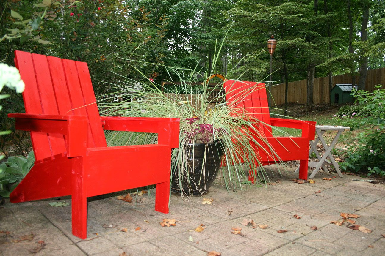 Furniture: Interesting Red Plastic Adirondack Chairs With Wooden Fence