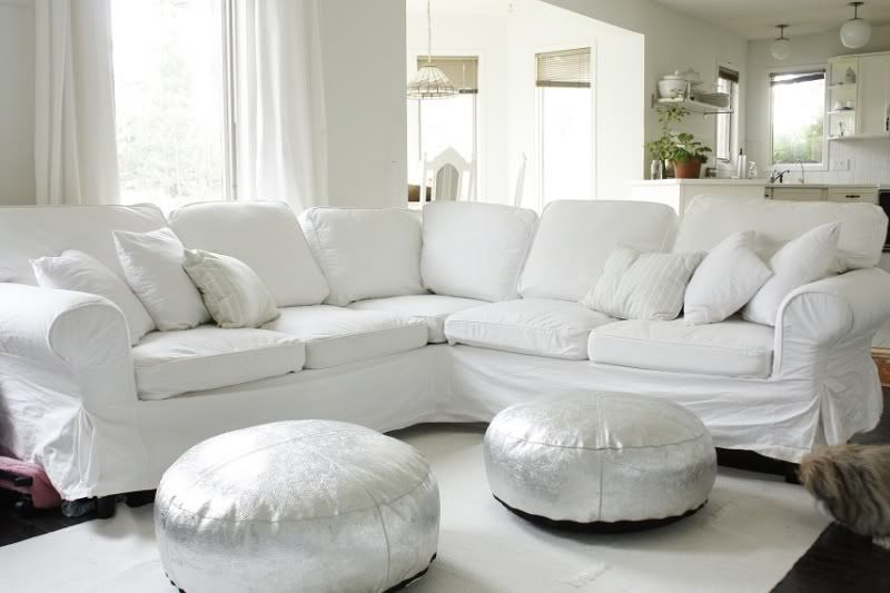 What S Not To Love White Slipcovered Couch Silver Poufs