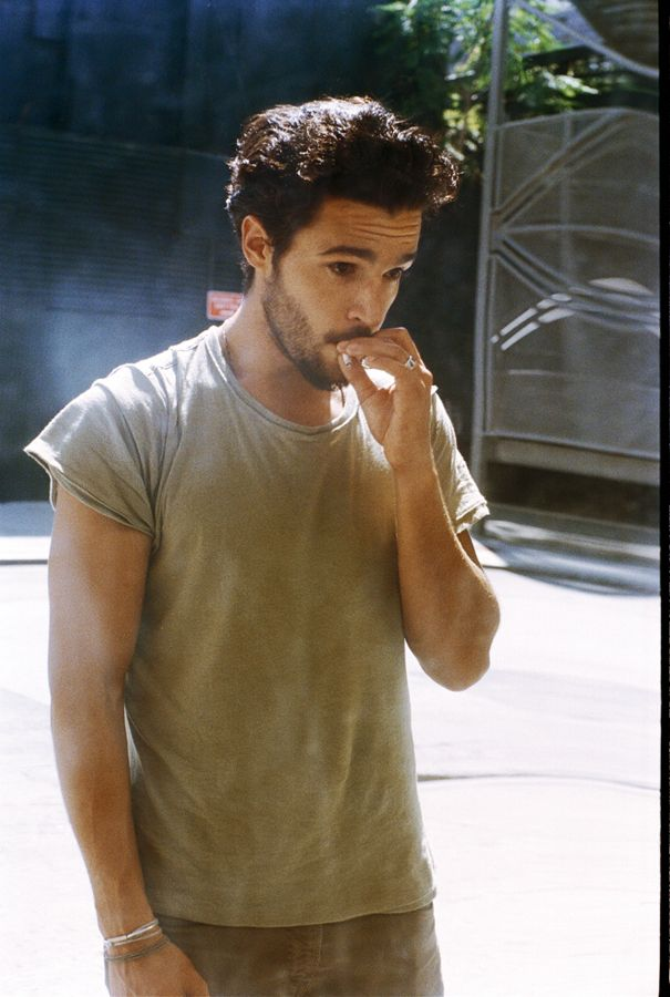 Christopher Abbott smoking a cigarette (or weed)