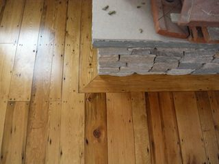 Fireplace frame scribed to stone fireplace. Recycled pine floors ...