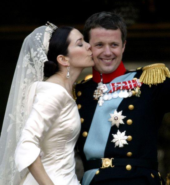 Danish Crown Prince Frederik And His Bride Princess Mary Kiss As The Royal Ear On