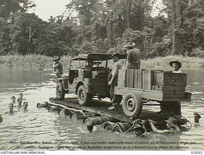 Jeep And Trailer Being Floated Across A River By Australian Troops