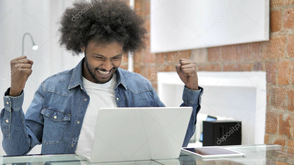 Excited African Man Celebrating Success - Stock Photo ,