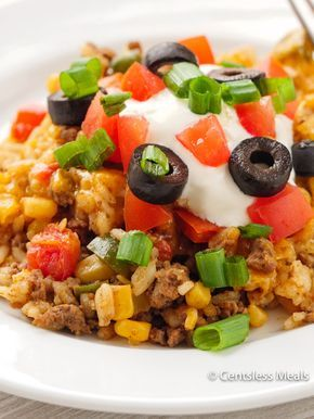 Easy Taco Casserole is a 4 step meal idea made with spicy beef, rice, tomatoes, mexicorn, salsa and topped with loads of cheese. This keeps well in the fridge and reheats amazingly if you are lucky enough to have leftovers the next day!
