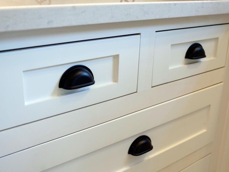 black cabinet hardware makes for a striking contrast with the new white cabinetry
