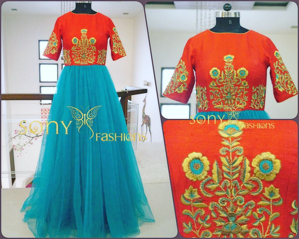 Beautiful orange and sea blue color dress with classy thread embroidery work from Sony reddy.