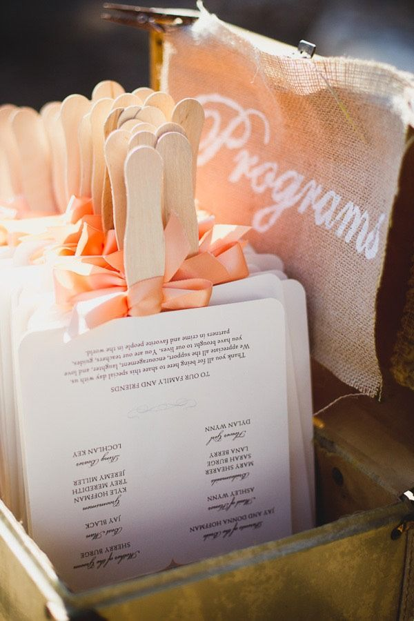 Turn your wedding programs into fans to help keep guests cool during outdoor weddings